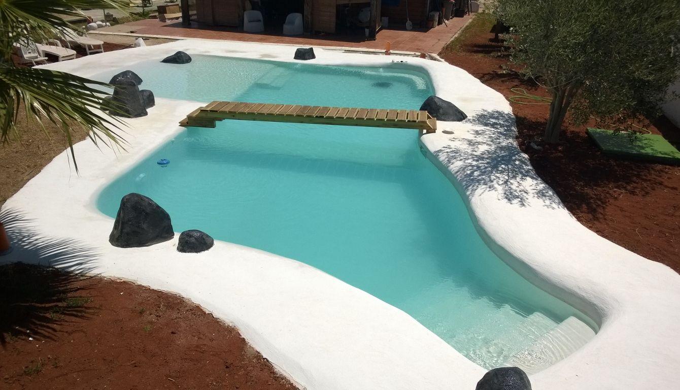 Piscinas ibericapool construcci n de piscinas de arena for Como hacer una piscina climatizada
