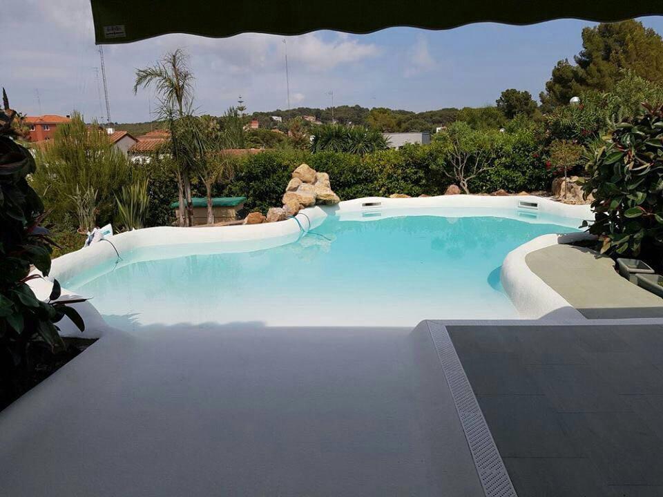 Piscinas ibericapool construcci n de piscinas de arena for Depuradora de arena para piscina
